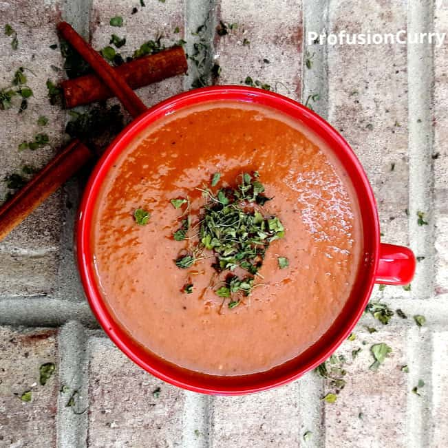Red bowl full of home made makhani sauce