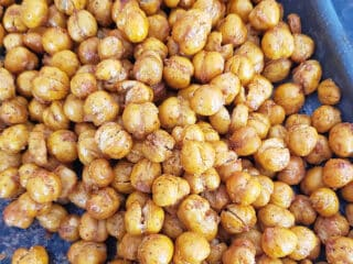 A close up of dry roasted and garam masala seasoned chickpeas showing crisp texture.