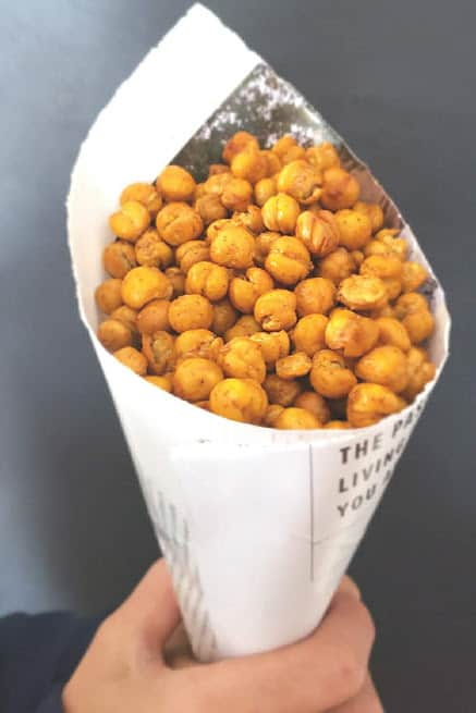 Dry roasted and seasoned garbanzo beans served in a paper cone just like street food vendors do in India.