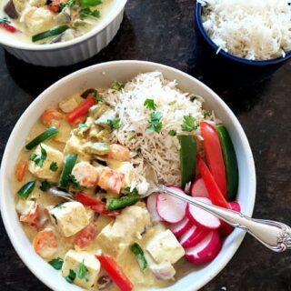 Vegan Thai Green Curry dinner served along with bowl of white rice.
