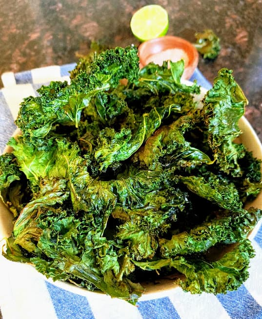 Crispy kale chips served in a bowl.