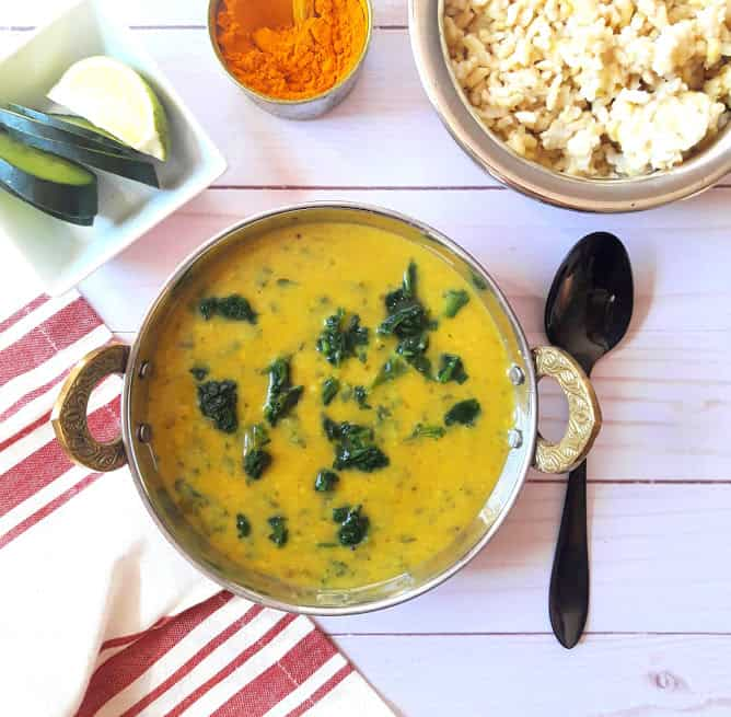 Dal Palak with Rice and turmeric in serving bowl