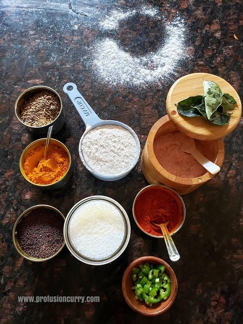 Ingredients displayed on granite countertop to make tandalachi ukad recipe.