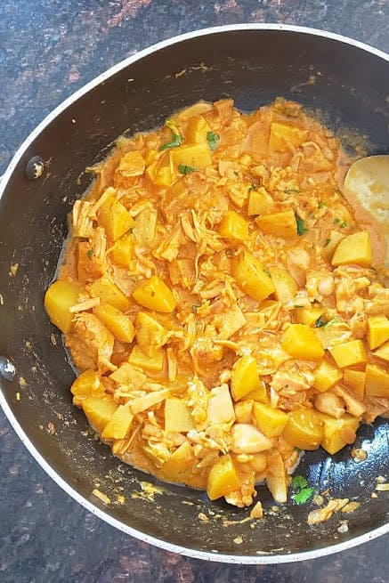 Golden yellow creamy curry full of healthy ingredients.