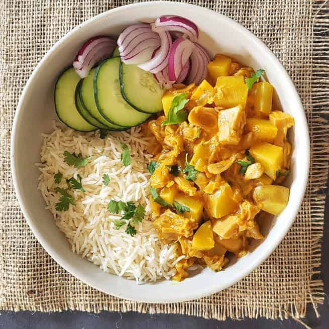 Green Jackfruit and potato coconut curry served with rice and pickle.
