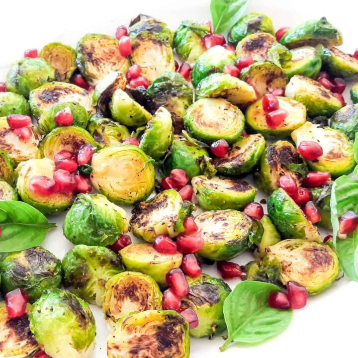Crispy Brussel Sprouts made in air fryer or oven or by pan frying on the stove top. Served with beautiful garnishes.