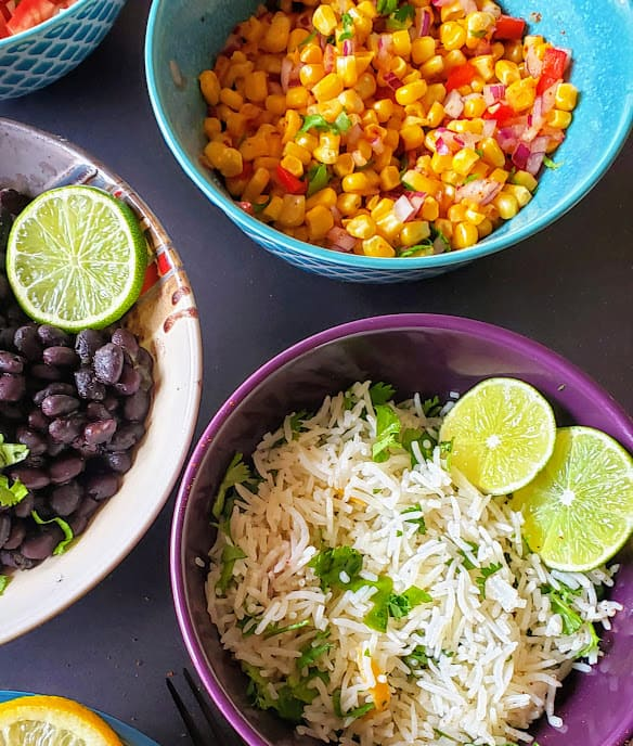 Cilantro lime rice and Mexican Corn salad bowls are part of do your own taco bar.