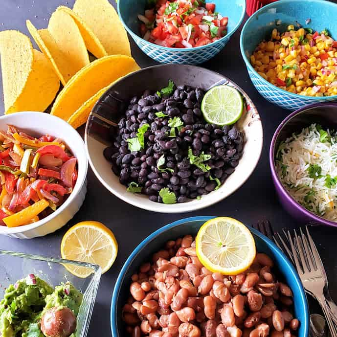 Seasoned Pinto Beans and Black Beans are part of taco fieasta.