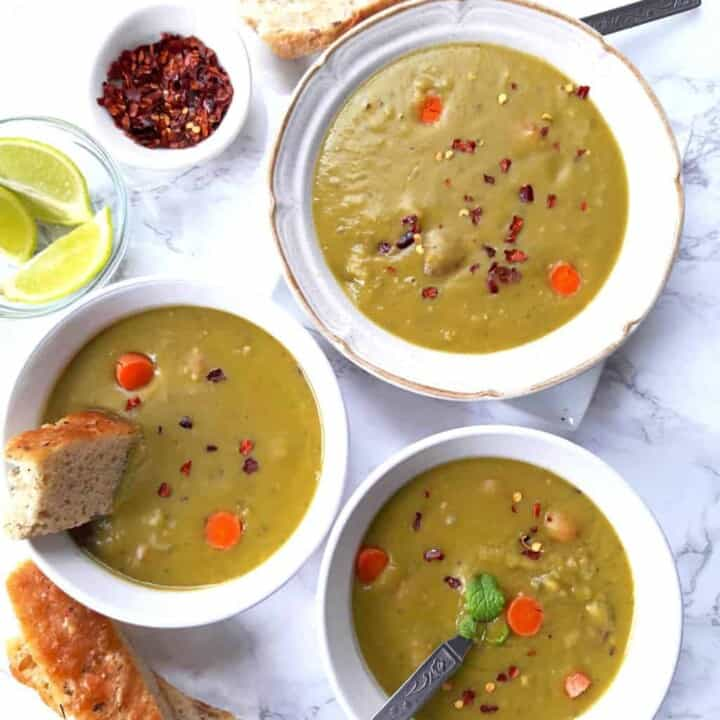 over head image of split pea soup dinner served with bread.