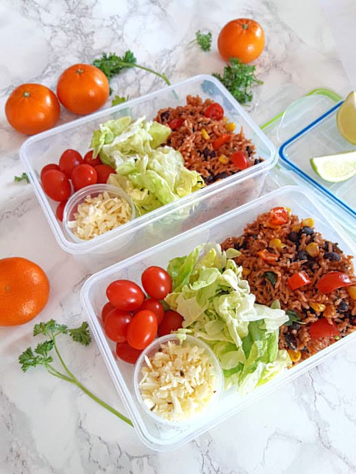 instantpot vegan Enchilada rice divided into two meal prep containers for lunch