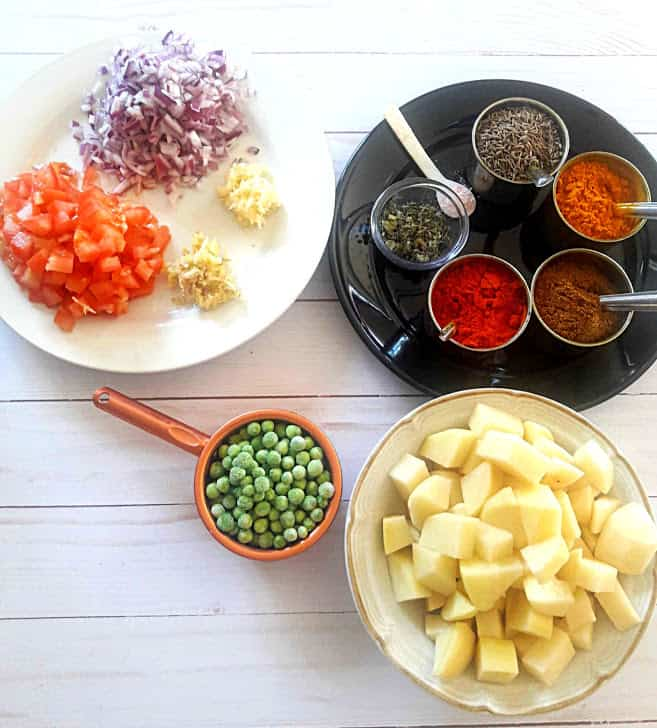 Ingredients needed to make Aloo Matar