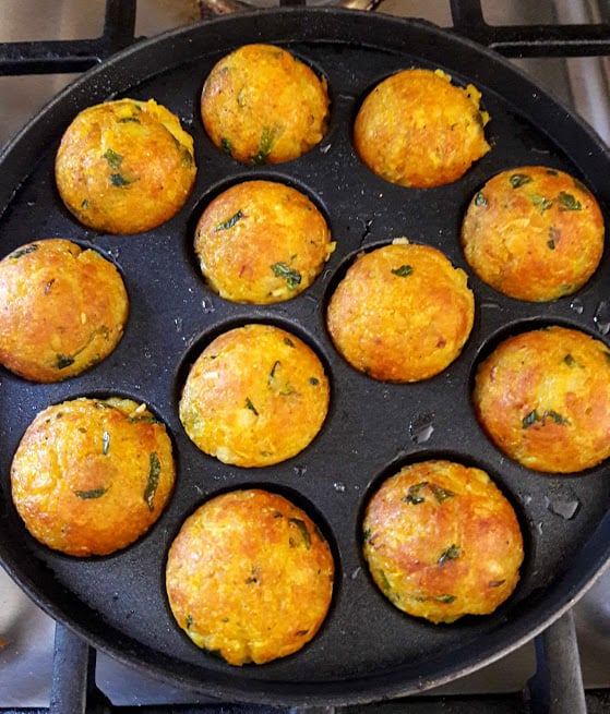 Cheesy Potato Poppers on Appe pan when turn golden brown ready to serve