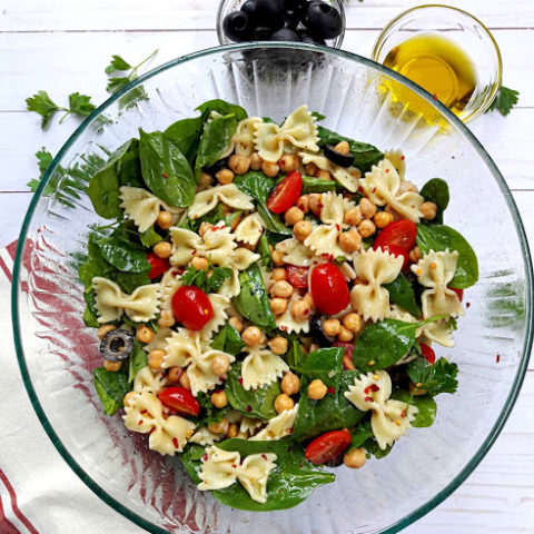 Greek Fresh Pasta Salad with parsely, olives and summer veggies. Overhead photo of profusioncurry recipe