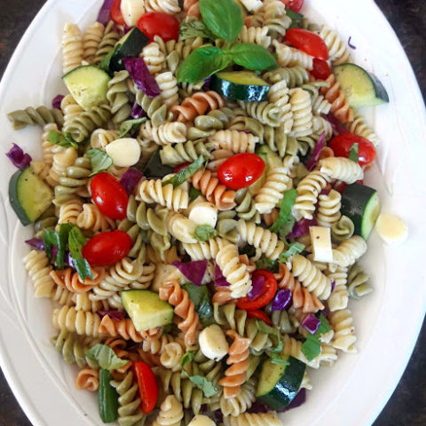 Italian Pasta Salad served cold to brighten your summer gatherings. Cooked pasta, rainbow veggies , marinated cheese make this delicious and easy side dish created by ProfusionCurry