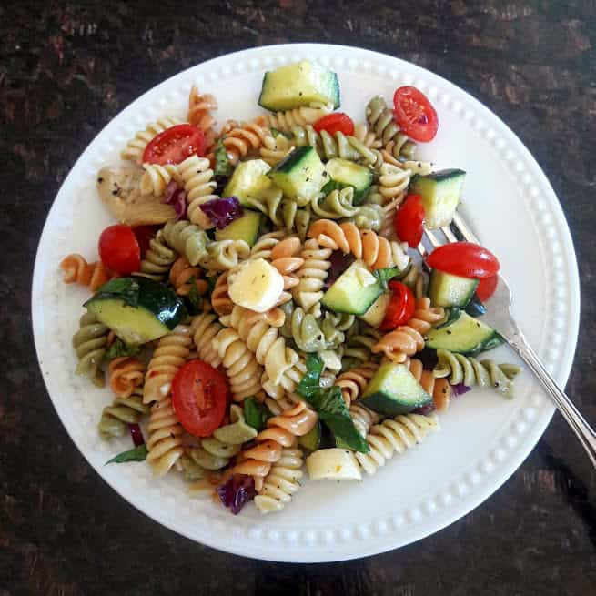 Classic Italian Pasta Salad with tri color rotini, cherry tomatoes, cucumbers, cheese and marinade. Perfect summer recipe by ProfusionCurry