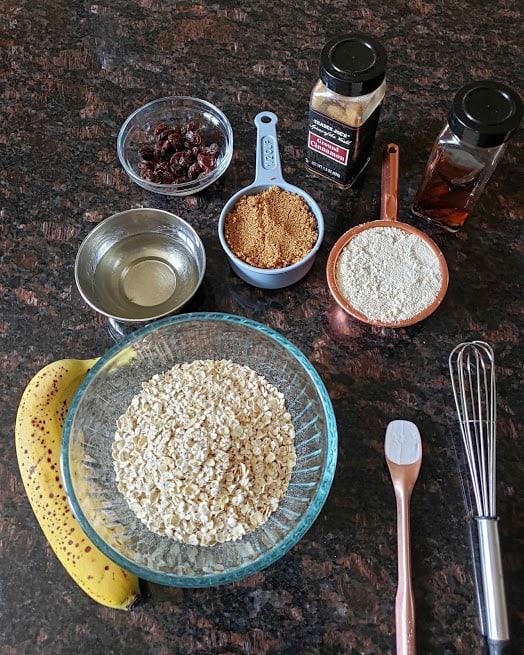 all ingredients displayed  to make glutenfree, vegan banana oatmeal raisin cookies