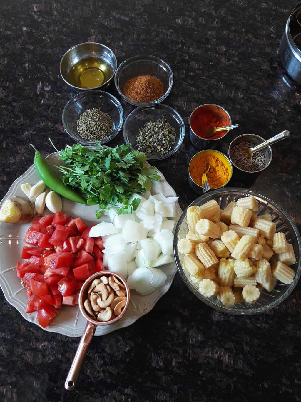 Ingredients used in making Baby Corn masala curry.