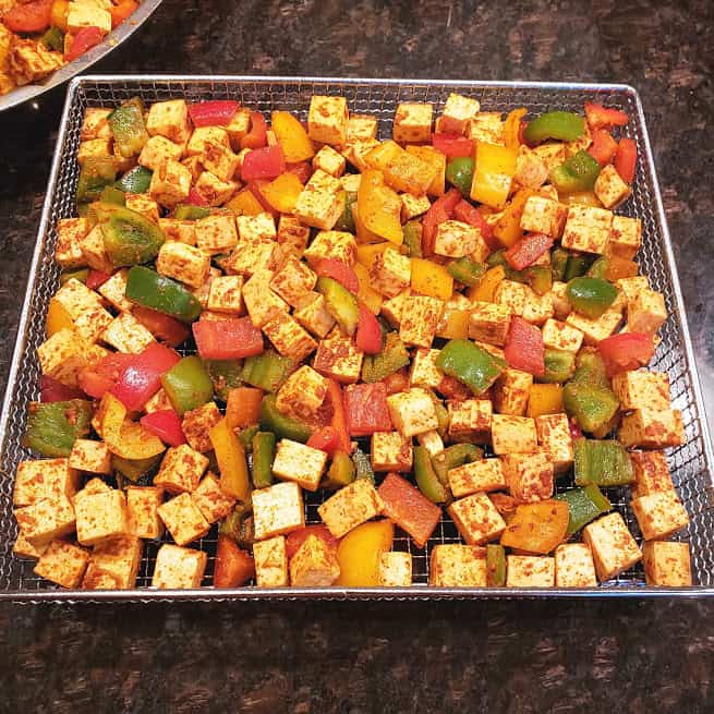 Marinated Panner and veggi stuffing with taco seasoning ready for Paneer Tacos.