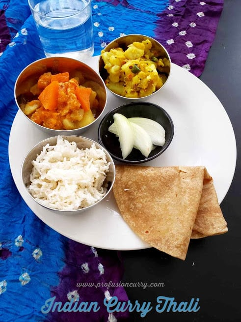 Indian curry platter with rice, roti , cut onions , pumpkin curry and potato dry curry. This scruptious meal can me whipped under 30 minutes using Instantpot.