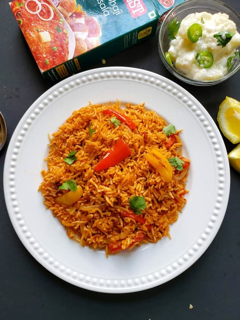 Tawa Pulao with pav bhaji masala on the side -featured image.