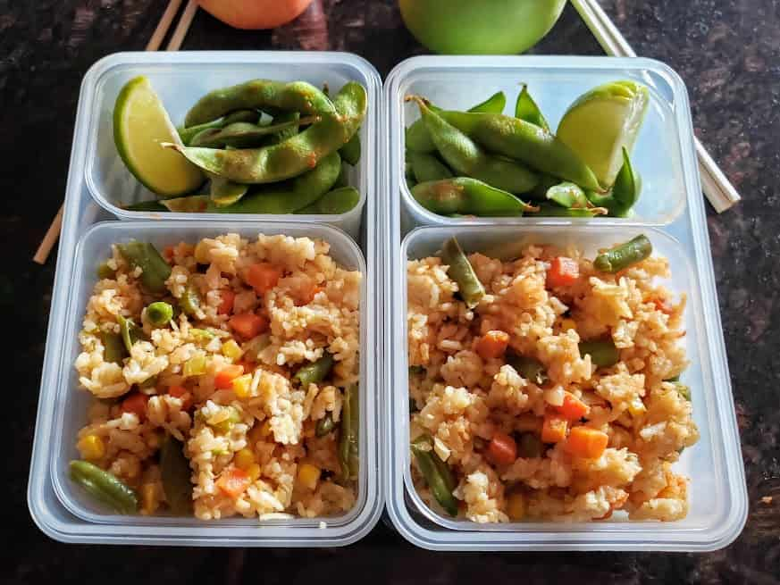 Vegetable fried rice packed like a bento box lunch along with Chili Garlic Edamame.
