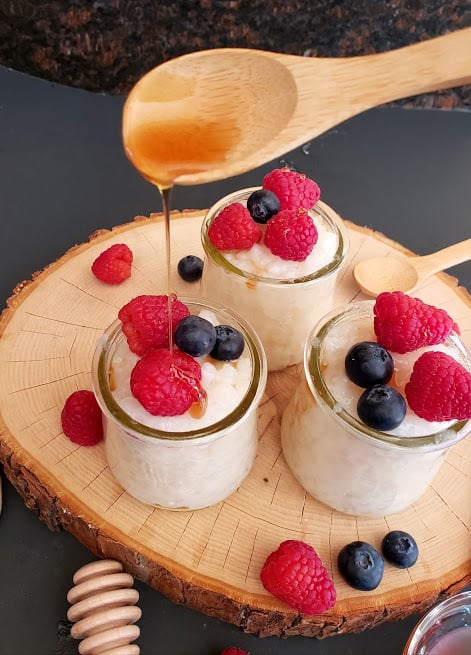Classic eggless tapioca pudding served in individual serving glasses and garnished with fresh berries and maple syrup. This vegan tapioca pudding is easily made in Instantpot.