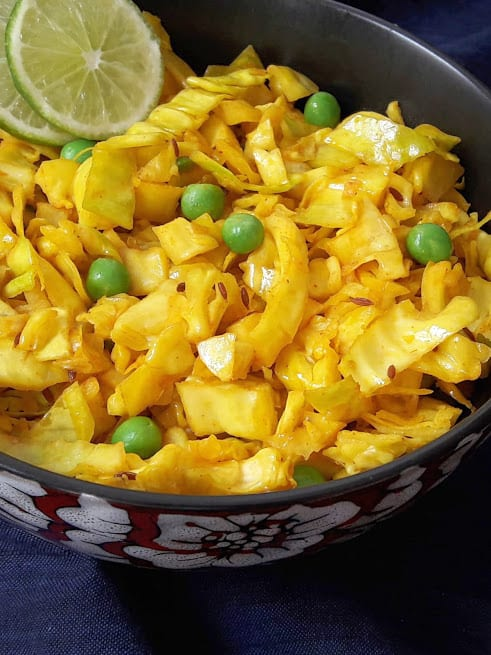 Close up photo of Cabbage peas turmeric stirfry showing beautiful color and crunchy texture.