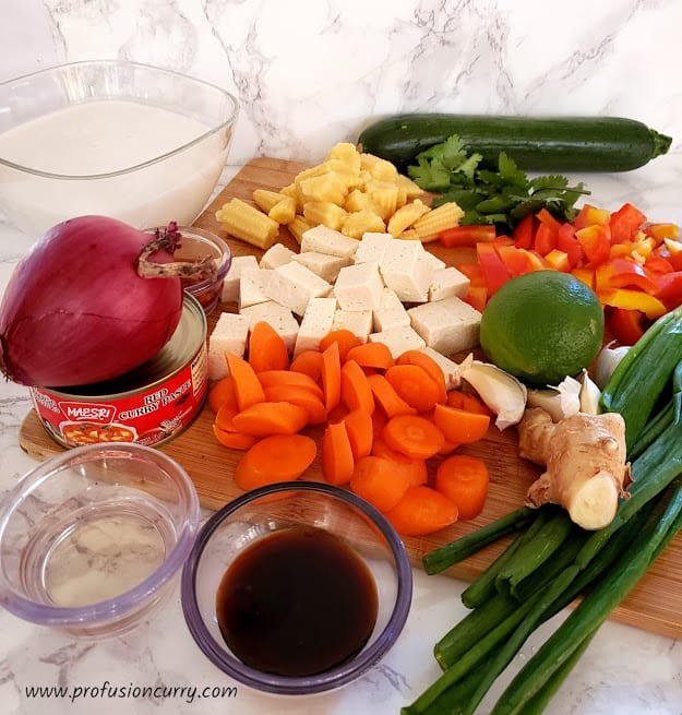Display of ingredients needed to make vegan Thai Red curry with tofu and vegetables.