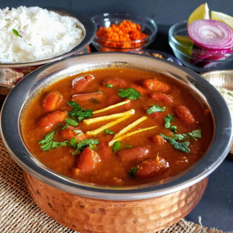 Red Kidney Beans curry served in copper container with white rice .