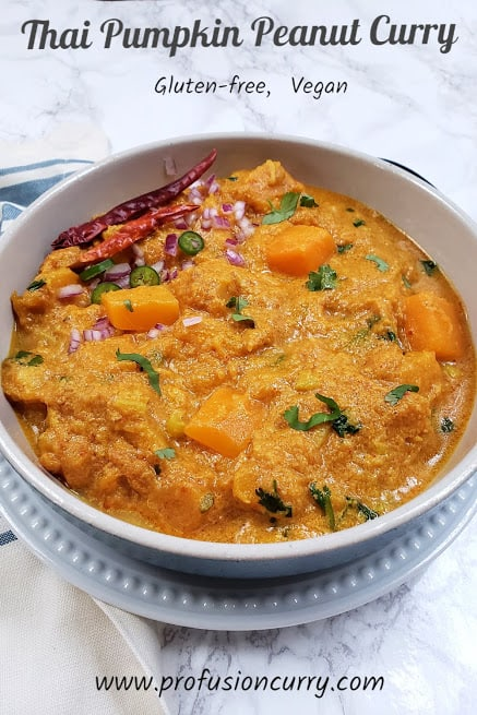 Pinterest image showing the pumpkin curry served in white serving bowl.