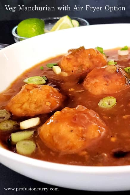 Air fried veg dumplings dunked in savory spicy Manchurian sauce to make popular Indo Chinese Veg Manchurian Recipe. This low calorie Profusioncurry recipe is perfect for party appetizer.