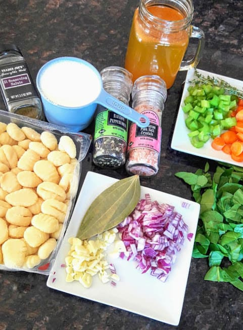 Display of ingredients needed to make gnocchi and vegetable soup.