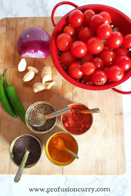 Display of ingredients to make tomato chutney recipe.