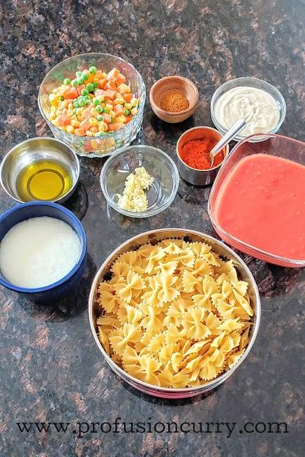 Display of ingredients to make Indian Italian cremay pasta