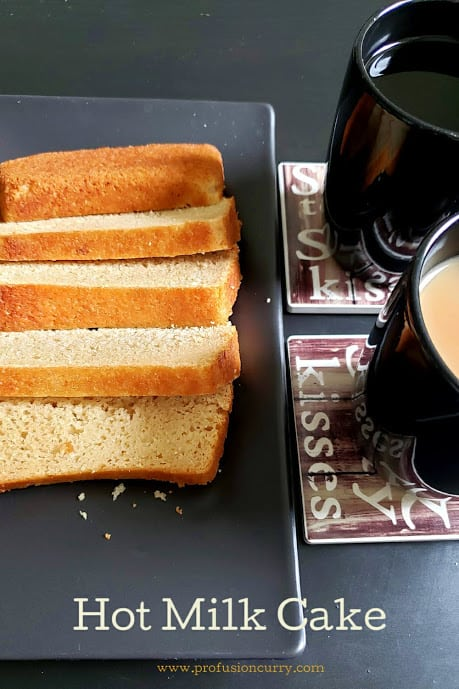 Super delicious and easy hot milk cake served with two coffee mugs for lovely evening snack.
