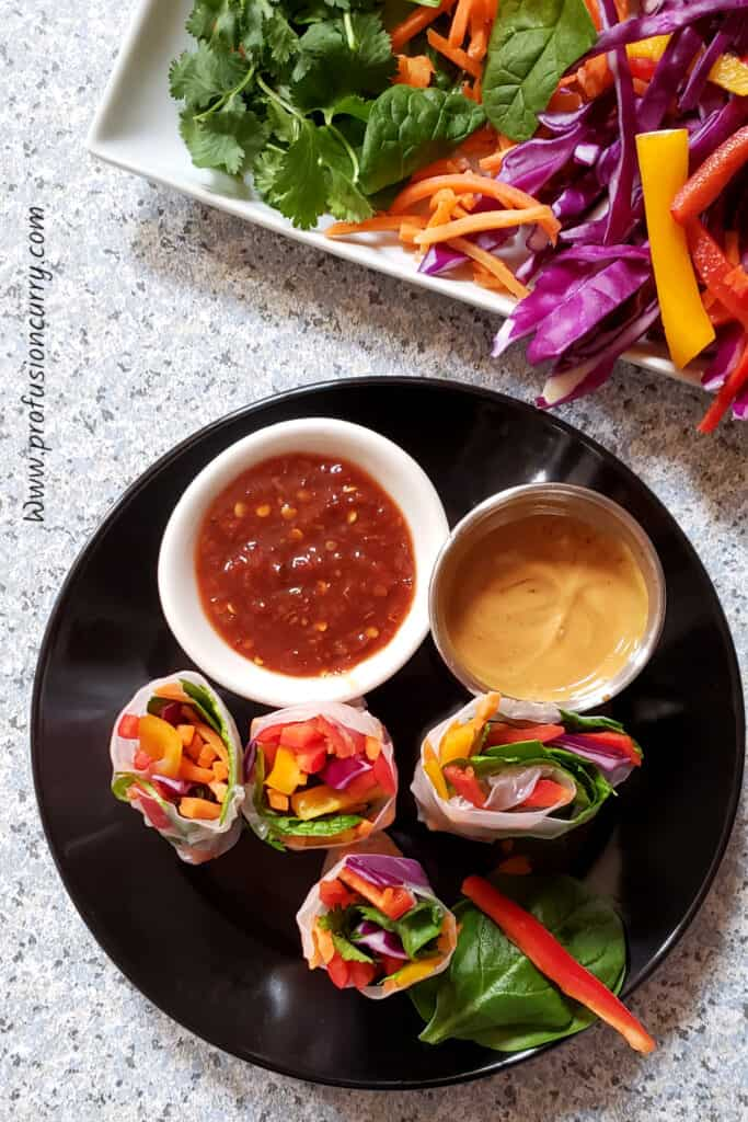 fresh vegetable filled rice wraps served with dipping sauces