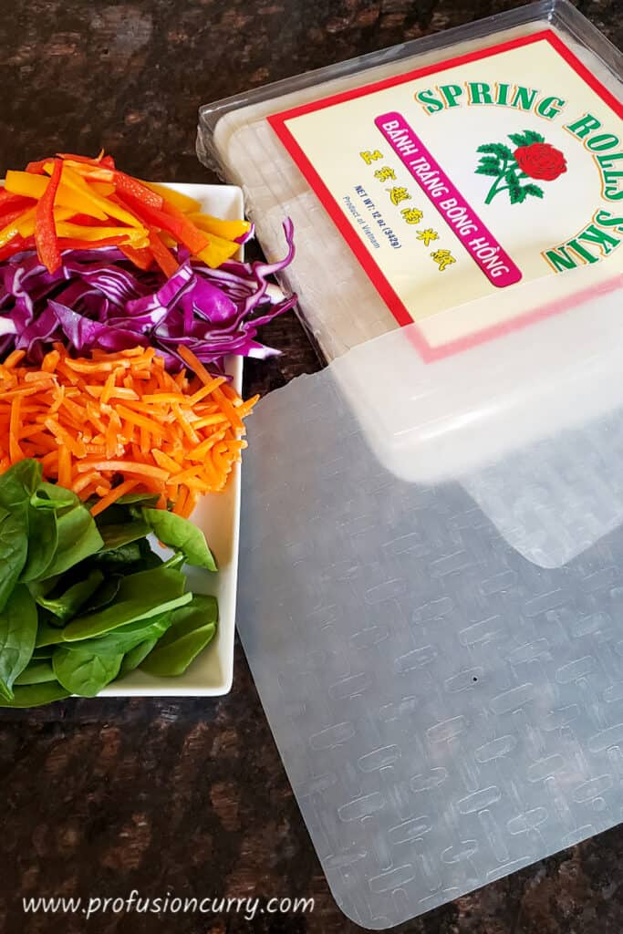 display of ingredients to make healthy spring rolls.