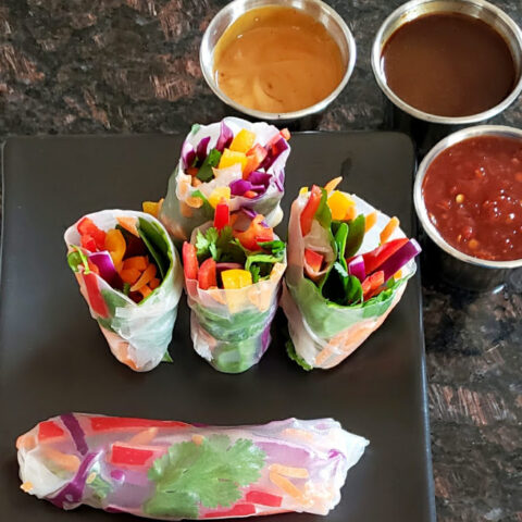 Fresh Vegetable Vietnamese Spring Rolls are served along with different dipping sauces. This delicious and beautiful Profusioncurry recipe is a must for summer and spring lunches.