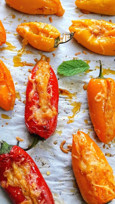 CLose up image of airfried stuffed peppers showing grilled cheese and charred peppers.
