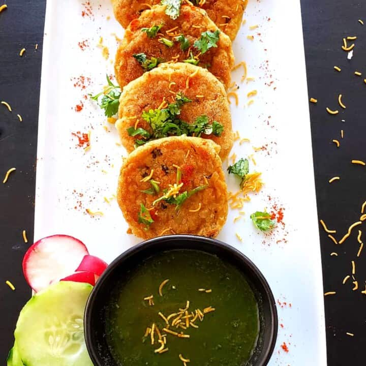 spicy potato cutlets served along with green chutney, cucumber and radish slices.