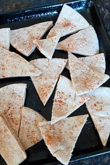 Pita bread cut into triangles and drizzled with olive oil and chili lime seasoning