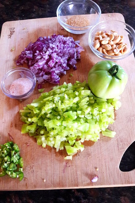 ingredients needed to make fresh green tomato onion salad.