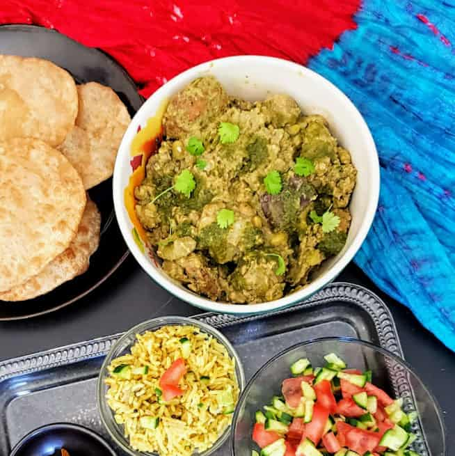 Easy Gujrati Undhiyu served with fried puri and salad.