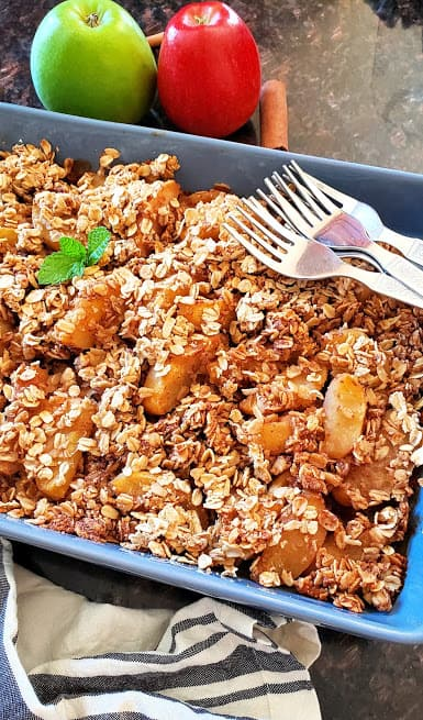CLose up photo of gluten free and vegan apple crisp made in oven safe casserole dish.
