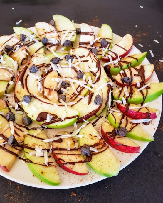 A close up image showing four different layers of these fruit nachos.