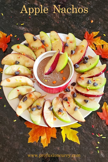 Apple Nachos decorated with fall theme sprinakles.