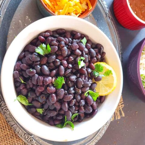 Cuban Style Seasoned Black Beans made from stratch. This recipe can be made in Instant Pot, stove top or crockpot.