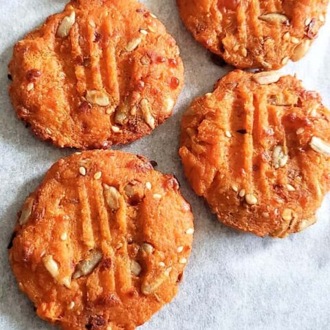 A close up of freshly baked pumpkin cookies.