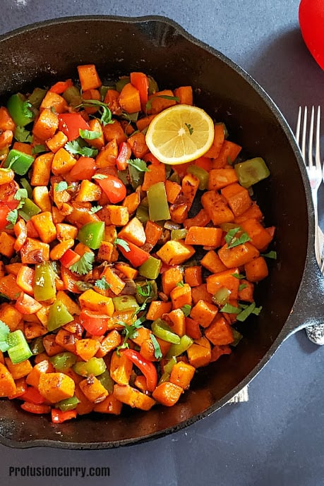 A close up image of sweet potato hash skillet showing crisp texture and beautiful colors.