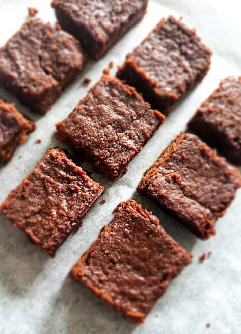 Sweet Potato Brownies cut into squares and arranged on parchment paper in diamond shape.